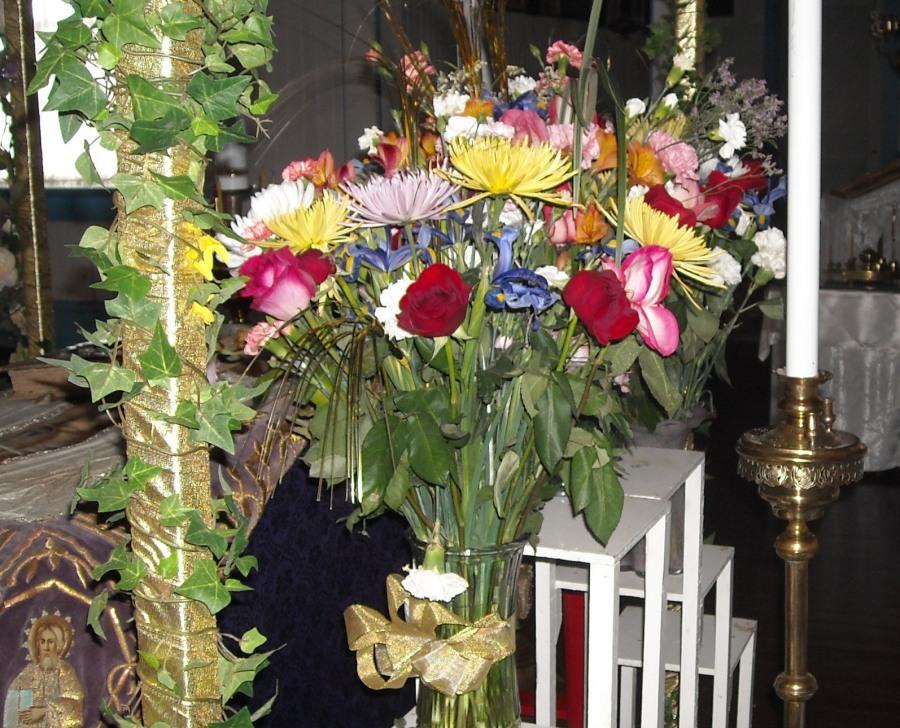 Flowers surrounding the shroud of Christ.