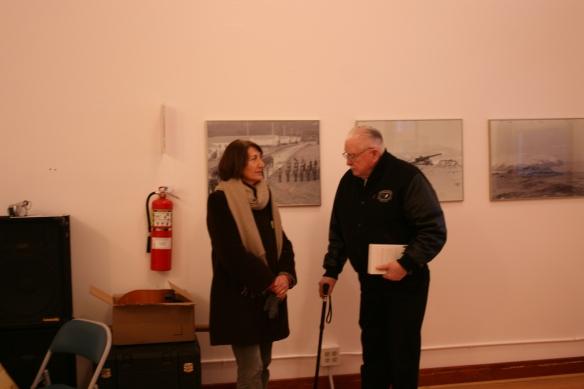 Zoya Johnson, talking with my Dad, Sam Svarny, at the StoryCorps opening reception.